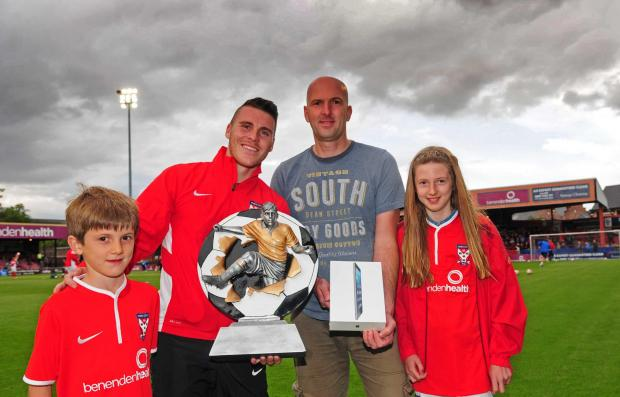 York City winger Josh Carson is pictured with Andy Parsons, of Helmsley Computers, and his children, Harry, and Phoebe at the launch of the Fan of the Year award