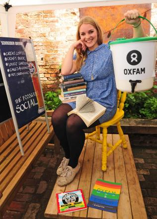 Oxfam volunteer Lindsay Rose prepares for a pop up event at the Fossgate Social.