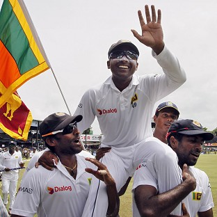 Mahela Jayawardene, centre, is carried by Chanaka Welegedara, left, and Dhammika Prasad following Sri Lanka's Test series win over Pakistan (AP)