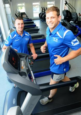 Danny Allan, manager of  Swift Gym, with rugby league star Peter Fox, who is training for the marathon