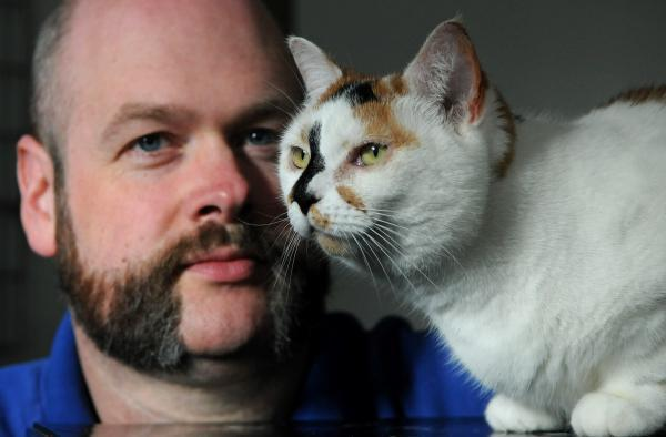 James Hodgkison of the Cats Protection York adoption centre with Angie, who needs a new home
