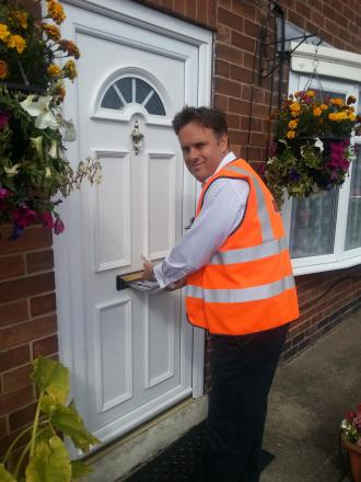 Julian Sturdy joins postie on his round in York