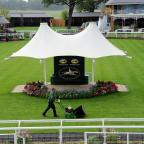 York Press: The team at York Racecourse in north Yorkshire put the finishing touches to the course ahead of welcoming an estimated 100,000 people to the Welcome to Ebor Festival which takes place from 20th to 23rd August. PRESS ASSOCIATION Photo. Issue date: Monday A