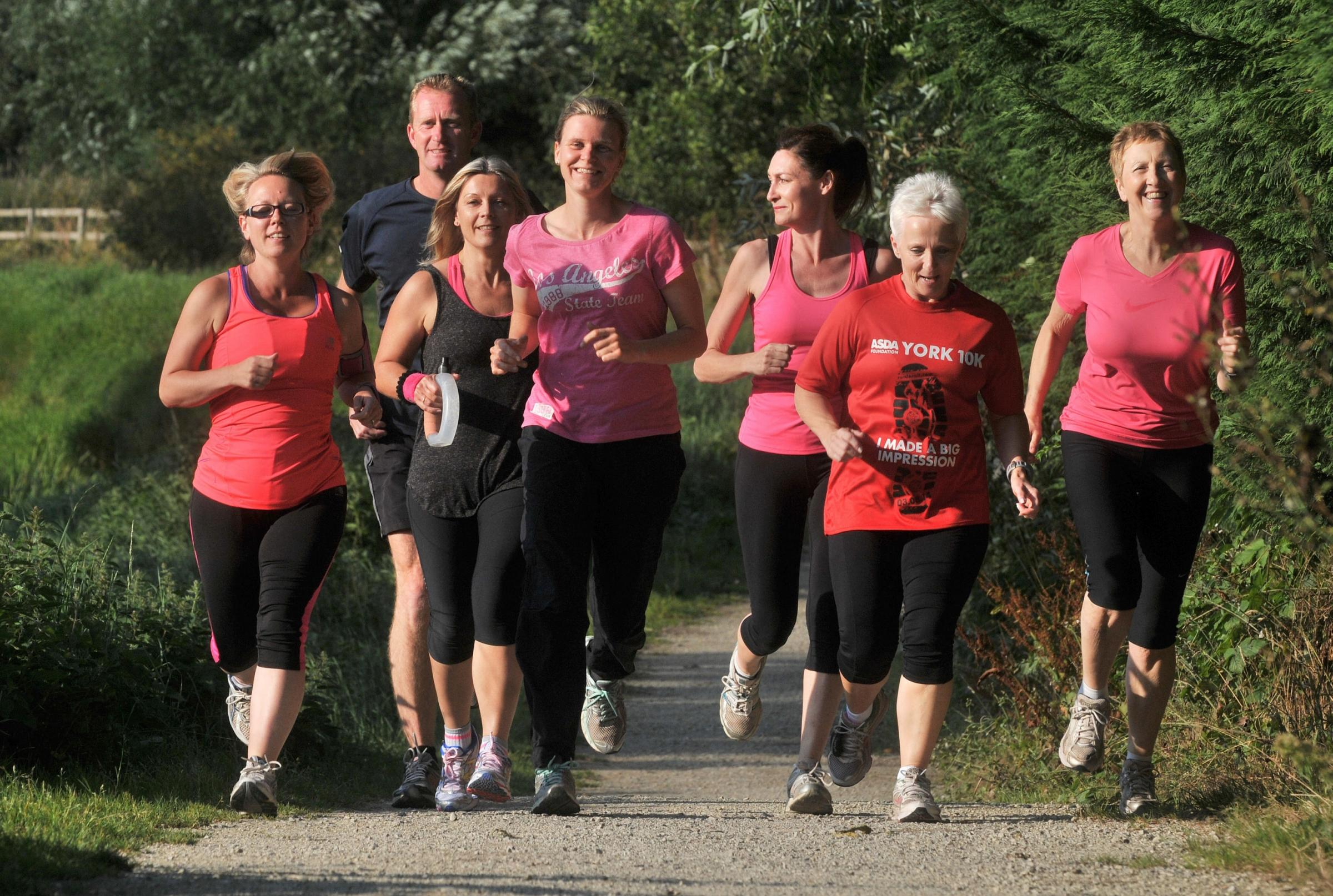 STRIDING OUT: Head coach Kathryn Lazenby, centre, with members of her Strensall Striders Running Club