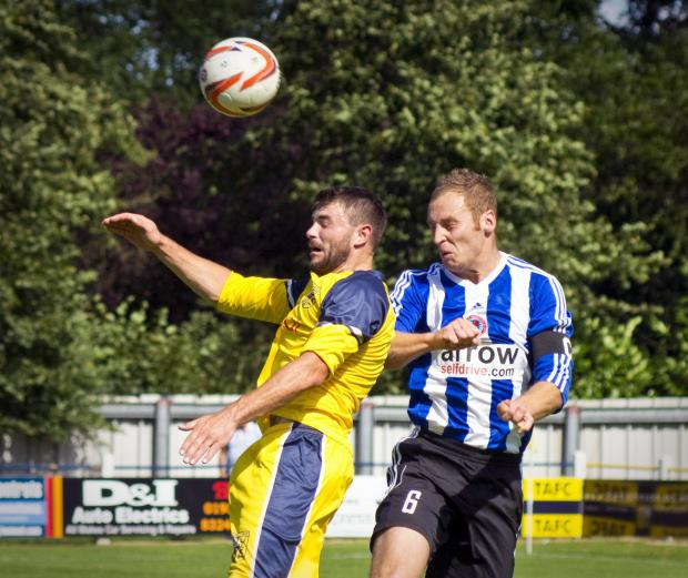 In-form Tadcaster Albion striker Carl Stewart in Northern Counties East League premier division action against Shaw Lane's Sam Denton