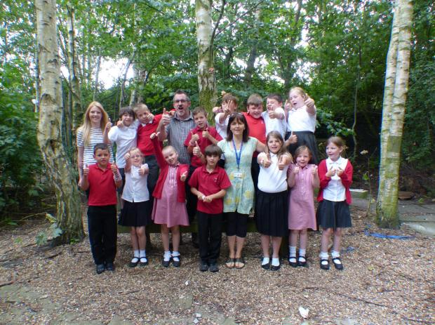 Barlby pupils give the thumbs up to the new bird feeders