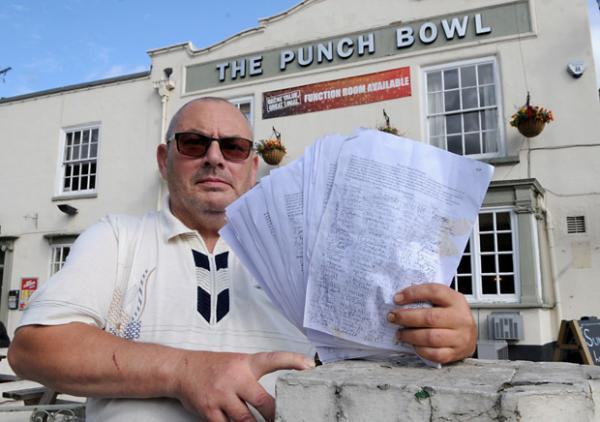 Paul Giller, a regular at The Punch Bowl pub, with the petition he has organised to save the pub in Lowther Street, amid fears it may close to become a Tesco supermarket