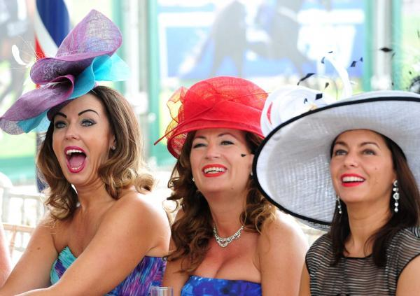 Racegoers enjoy themselves despite the threat of rain at the Ebor Festival