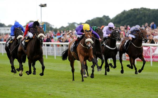 Pale Mimosa, ridden by Pat Smullen, centre, with yellow cap, wins the Weatherbys Hamilton Insurance Lonsdale Cup on day three of the Welcome To Yorkshire Ebor Festival at York Racecourse. Picture: Anna Gowthorpe/PA Wire