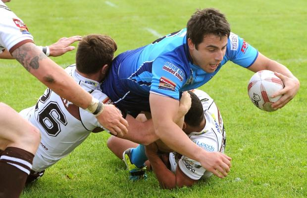 York City Knight's Jack Lee dives over to score a try during the match against Hunslet Hawks.