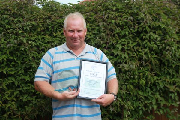 Acomb Cricket Club junior coach Simon Brown with his Outstanding Services to Cricket Award