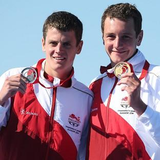 Jonathan Brownlee, pictured left, beat his brother Alistair, right, in Stockholm