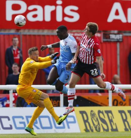 York City goalkeeper Michael Ingham is beaten to the ball by Exeter goalscorer David Wheeler