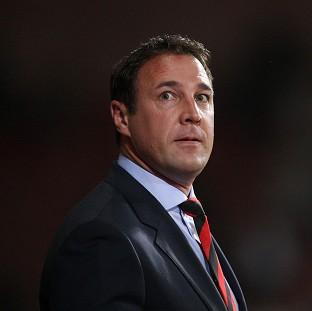Malky Mackay has apologised for sending three offensive text