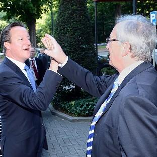 David Cameron and Jean-Claude Juncker at the European Parliament in Brussels (European Union/PA)