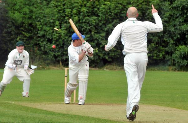Harrogate's Ollie Driver bowls Osbaldwick batsman Dan Heard watched by keeper  Henry Burton in division two north of the Hunters York & District Senior Cricket League