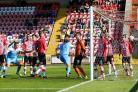 Central kingpin Keith Lowe powers his equalising goal past Exeter City's Christy Pym