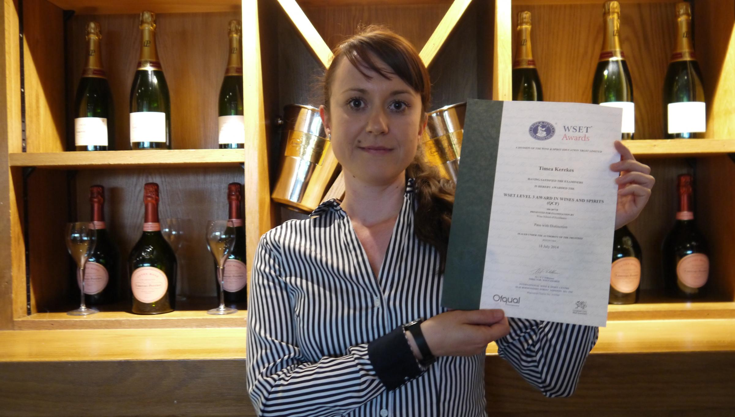 Stamford Bridge restaurant manager Timi Kerekes with her certificate from the Wine and Spirit Education Trust