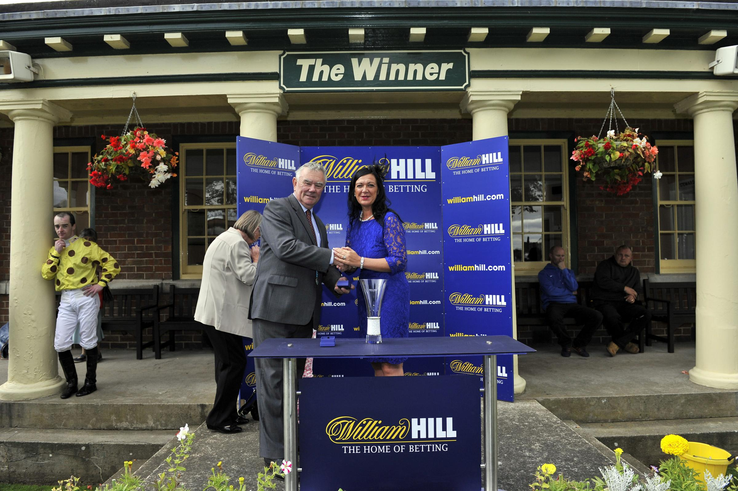 Karen Hanson the Area training officer for William Hill presents Duke Cosimo trainer David Barron  with the  William Hill Silver Trophy during the William Hill Great St.Wilfrid Handicap Day at Ripon Racecourse, Ripon.
