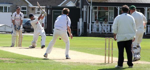 Tim Hall hammers a straight six for Sessay in the division one duel at Pickering Picture: Jo Hughes