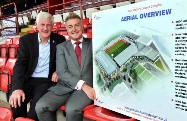 Manager Nigel Worthington and chairman Jason McGill with the plans for the new stadium