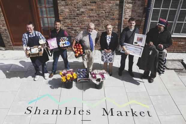 Cllr Sonja Crisp and market  traders, from left, James Harvey, Paul Anderson (chair of the market traders' association), John Mannion, Leigh Boxall and Rupert Harrison, at the launch of Shambles Market's new logo