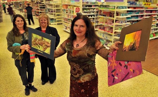 Sarah Jane Mackenzie, right, who is to hold art and craft classes at Tesco's Askham Bar to inspire those with mental health problems, with the help of her sister, Helen Mackenzie, watched by Wendy Heptinstall