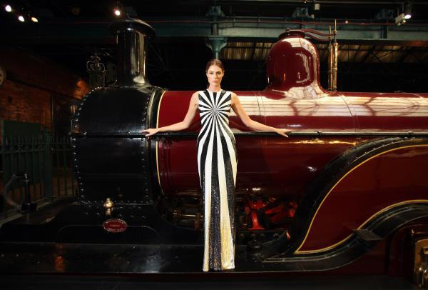 A model shows a Matthew Williamson dress ahead of the The Prince's Trust annual fashion dinner