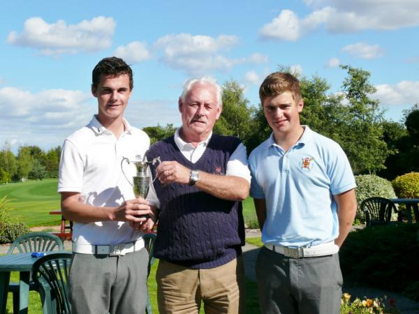 David Hague, left, receives the York Union of Golf Clubs' Matchplay Championship trophy from Union president David Smith, watched by runner-up James Cass