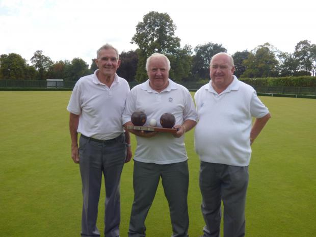 With their winners' trophy, from left, Bootham's Denis Dawson, Mick Head and Bob Procter