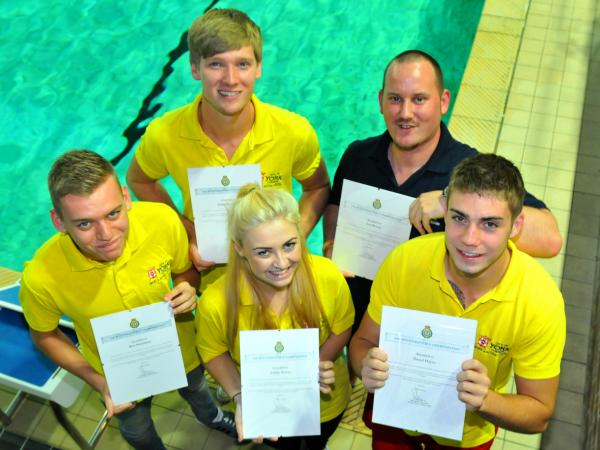 Yearsley Pool Lifeguards who were honoured for saving the life of a customer who suffered a heart attack are, from left, Ben Nicholson, Jonny Woodford, AshleyDower, Lee Brown and David Hayes
