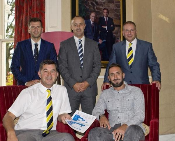 Jonathan Greening, front right with manager Paul Marshall, and back, from left, Tadcaster  directors James Gore, Kent Mayall and Matt Gore