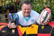Robert Powell with his rugby kit which is to be taken to Uganda.