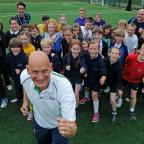 York Press: Olympic gold medal winning swimmer Duncan Goodhew, an ambassador for The Golden Mile, joins pupils from York Primary Schools and members of Premier Sport during a training session at the former Burnholme College. Pic: Mike Tipping (10858859)