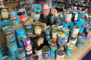 Volunteer Geoff Batterbee with some of the baked beans at the Hambleton Food Share.
