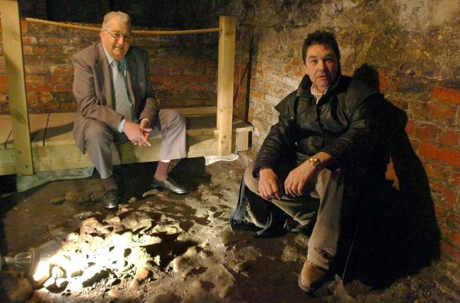 Harry Martindale, left, in the cellars of the Treasurer's House, York, the scene of his ghostly sighting. Pictured with author and paranormal historian Richard Felix
