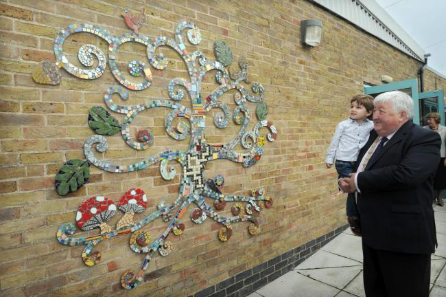 Three-year-old Ethan Downing, the youngest contributor to the Acomb Explore mosaic, with the Lord Mayor of York, Cllr Ian Gillies, after the official unveiling.