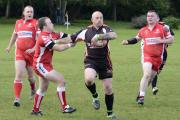 Sherburn Bears forward Matt Orford bursts through the Farnley defence to score a try