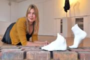Press officer Saskia Angenent admires the work of sculptor Rafael Perez at the Rea Gallery at the University of York