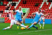 York City defender Keith Lowe thwarts his old club Cheltenham Town