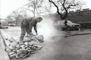 A workman cutting into the road surface in Lower Priory Street, York