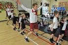 Diver James Denny, right, and Paralympic sprinter Lee Whiteley, left, are pictured working out with pupils at a Sports For Schools event at St Oswald's School, Fulford