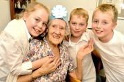 Ninety-year-old Ethel Inman meets St Aelred's Primary School pupils, from left, Millie James, Oliver King and Ceiran Sherratt during a visit to Woolnough House