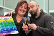 National Lottery scratch card winner Kelly Topping, from Easingwold, celebrates her £100,000 win with her husband Kevin