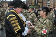 The Lord Mayor presents a medal to a medic during the parade