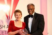Angela receiving the Hall of Fame award from Ralph Boston, who won the silver medal in the long jump at the Tokyo 1964 Olympics. Picture: Huw Evans Picture Agency