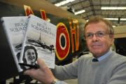 Director of the Yorkshire Air Museum, at Elvington, Ian Reed, Pictured in front of the museum's Halifax, with the new book The Bright Squadrons.