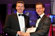 Robert Burns of 9xb, left, receives the Technology Business of the Year award from Stephen Ridley of sponsor Hiscox UK at The Press Business Awards at York Racecourse