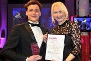 Young Entrepreneur of the Year winner Joe Carnell receives his award from Sue Reece, of sponsors York St John University