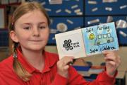 Eleanor Hoyland with her winning design for a parents' parking promise at Robert Wilkinson primary school Strensall.